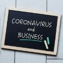 Coronavirus and business written on a chalkboard