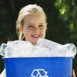 girl holding a blue recycling bin