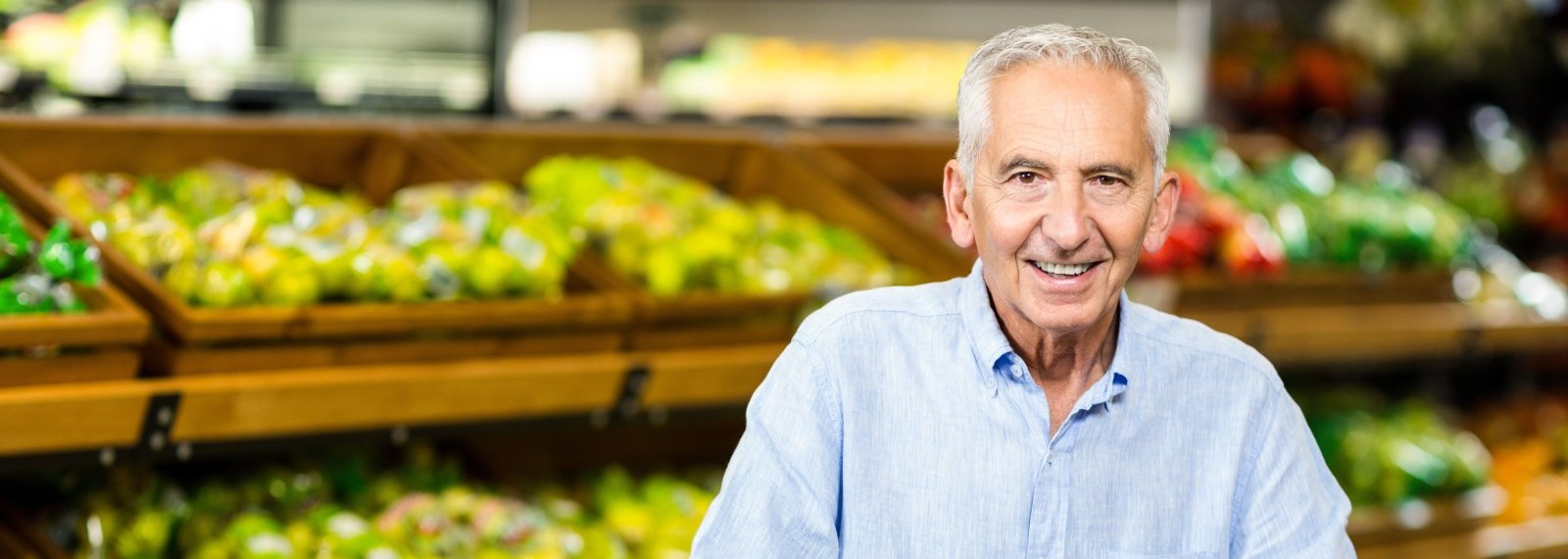 senior man shopping in a grocery store