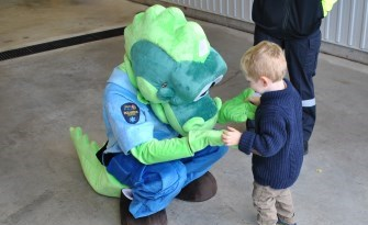 little boy and paramedic mascott