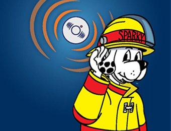 Sparky the Fire Safety Dog listening to an alarm