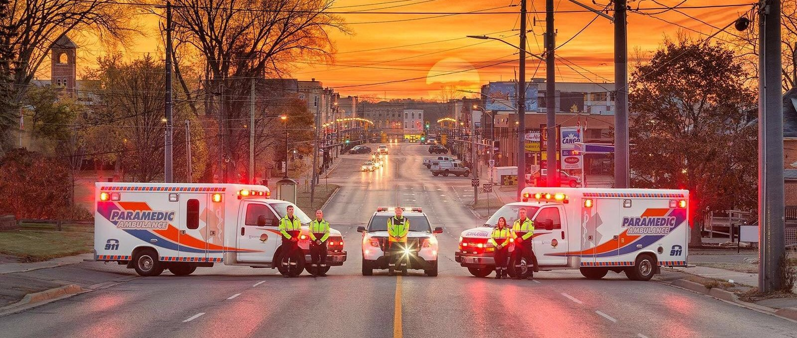 Kawartha Lakes Paramedics in front of sunset