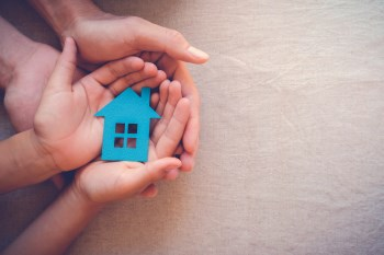 Small house held in hands