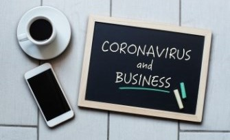 Coronavirus and business written on a chalk board