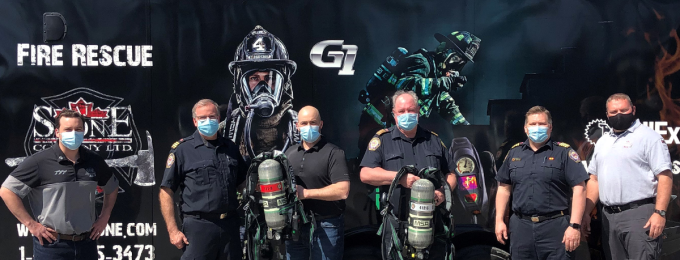 Fire Rescue Services and AJ Stone Company posing with the SCBA Device