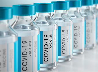 Bottles of COVID-19 vaccine in a row
