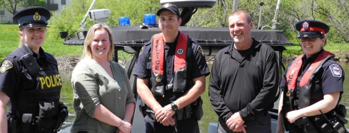 Police Constable Jackie Hildenbrand, Aquatics Coordinator Heidi Fisher, Police Constable Adam Nicholson, Mayor Andy Letham and Police Constable Carrie Jenkins.