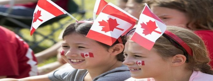 two young girls celebrating Canada Day