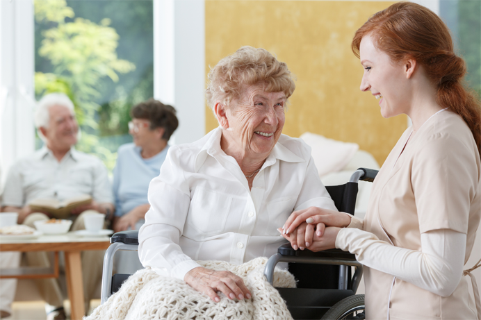 Female Senior Laughing with Support Worker