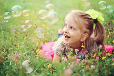 girl with bubbles in grass